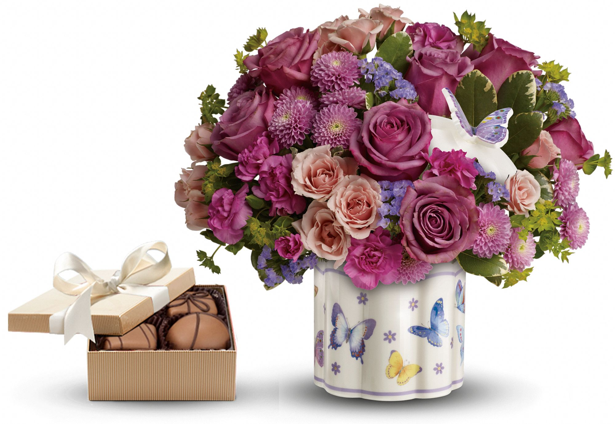 flowers in a ceramic jewelry box and chocolates