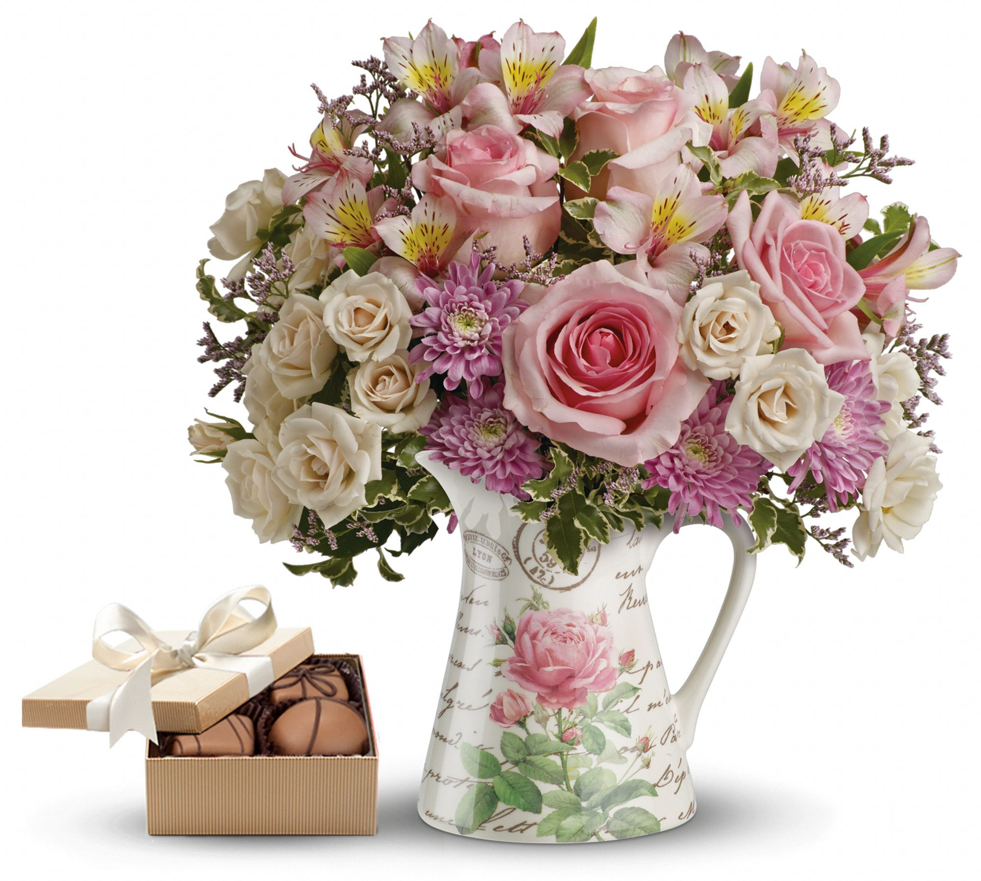 flowers in a French country pitcher and a box of chocolates