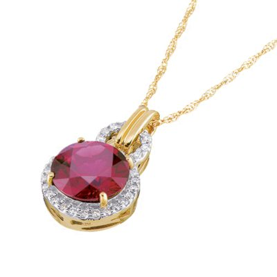 Garnet and Diamond Accent Pendant in 14K Yellow Gold.  Ends: Jan 29, 2015 3:00:00 PM CST