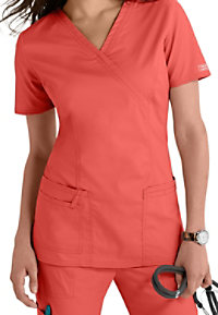 Cherokee Workwear Core Stretch mock-wrap scrub top.