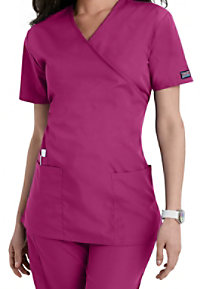 Cherokee Workwear mock-wrap scrub top.