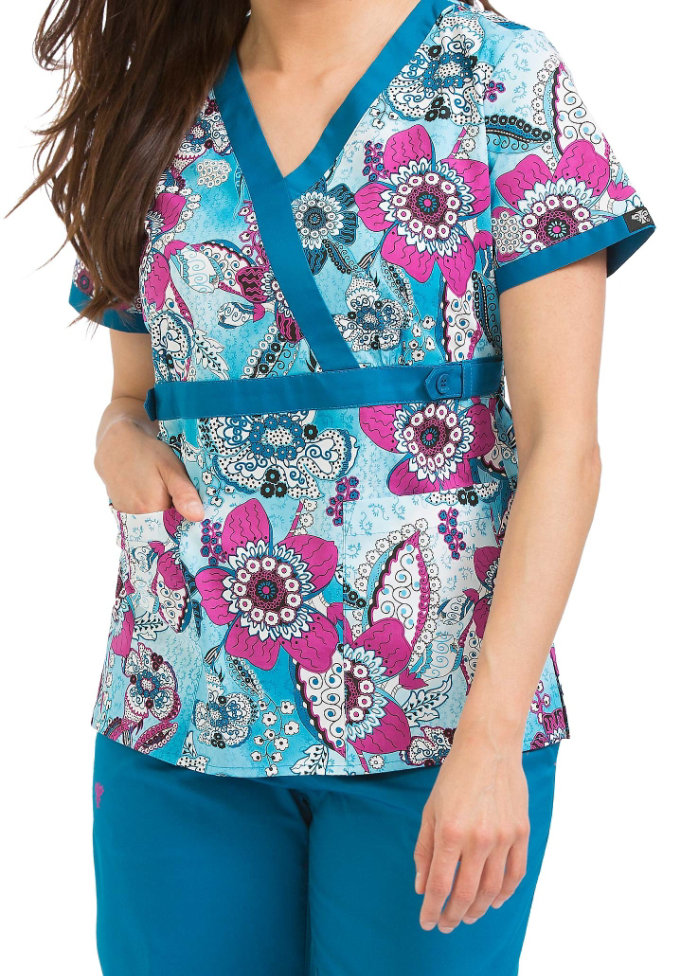 Med Couture Good Vibes crossover print scrub top.