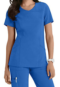 Urbane Performance Propel crossover scrub top.