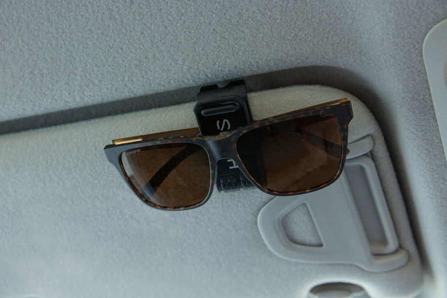 clip attaches easily to most vehicle sun visors