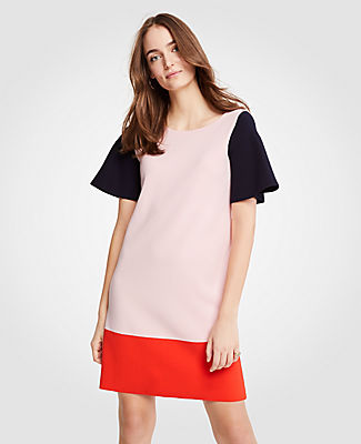 Bold, blocked and styled with confidence, this graphic standout merges clean lines with high impact color. Jewel neck. Short sleeves. 35 from shoulder to hem.