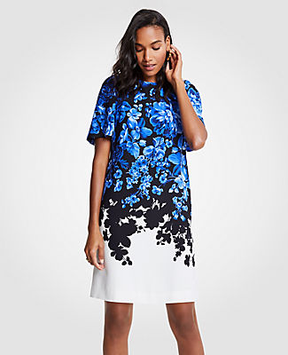 Blooming with lush florals, our flare sleeve shift dress is a romantic silhouette you'll reach for again and again. Jewel neck. Short sleeves with shirred sleeve caps. Back keyhole with button closure. Lined body, unlined sleeves. 19 1/2 from natural waist.