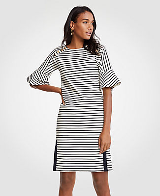 Punctuated with button detail, our fluted sleeve shift dress is nautically striped for a clean and classic look. Crew neck. Short sleeves. Grosgrain side slits. 21 1/2 from natural waist.