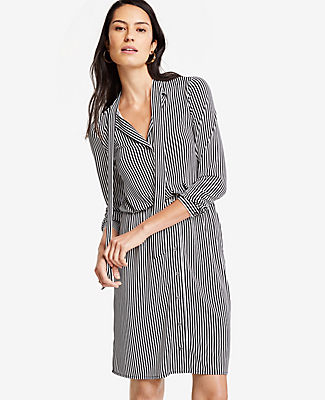 Tied at the neck or styled free and loose, our striped shirtdress is the answer to around-the-clock ease. V-neck with self ties. Long sleeves with button closure. Button front. Hidden elastic waistband. 22 from natural waist.