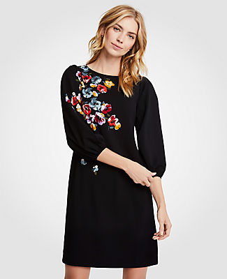 Inspired by spring's freshest blooms, our balloon sleeve shift is flourished with perfectly-placed florals in rich, romantic hues. Jewel neck. 3/4 sleeves with shirred sleeve caps and cuffs. 18 1/2 from natural waist.