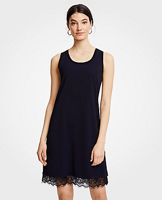 Meet your real-life uniform: this is Luxewear. Every day. Every wear. In a soft and stretchy knit, this easy tank dress gets a major upgrade from a feathery lace hem. Scoop neck. Sleeveless. 22 from natural waist.