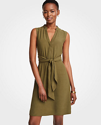 Meet your real-life uniform: this is Luxewear. Every day. Every wear. Nothing's more summer-ready (or travel-friendly) than our tie front shirtdress - just cinch and go. Mandarin collar. Sleeveless. Hidden button front placket. Self tie belt. Hidden side zipper. 20 1/2 from natural waist.