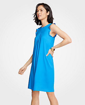 An inverted pleat front adds extra ease and fluidity to our breezy shoulder ruffle shift. Jewel neck. Sleeveless. Inverted pleat front. Back keyhole with hook-and-eye closure. Lined. 19 1/2 from natural waist.