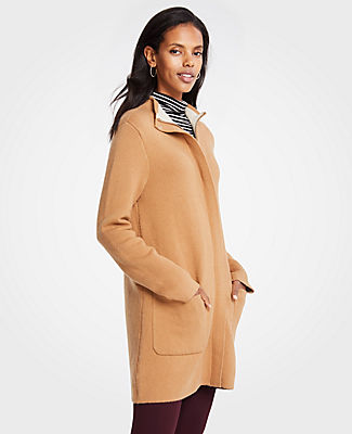 Meet your real-life uniform: this is Luxewear. Every day. Every wear. Topped with a flattering mock neck, this cozy topper stands up to the chill - with the structure of a coat and the ease of a cardigan. Mock neck. Long sleeves. Hidden zip front with snap closure. Front patch pockets.