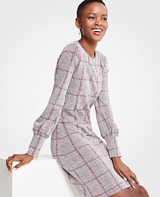 Meet your real-life uniform: this is Luxewear. Every day. Every wear. Give yourself a check plus with our soft plaid dress, highlighted with smartly cuffed sleeves. Jewel neck. Long sleeves with shirred cuffs. Hidden back zipper with hook-and-eye closure.