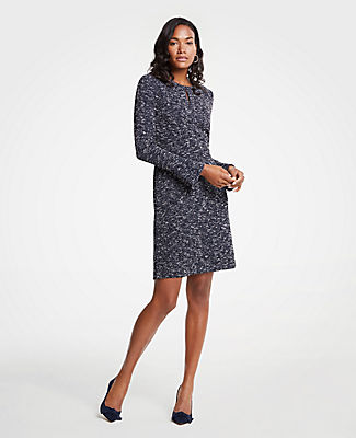 Finished with feminine flare sleeves, our beautifully marled tweed dress weaves instant magic into your fall wardrobe. Jewel neck with front slit and hook-and-eye closure. Long sleeves. Hidden back zipper with hook-and-eye closure. Lined bodice.