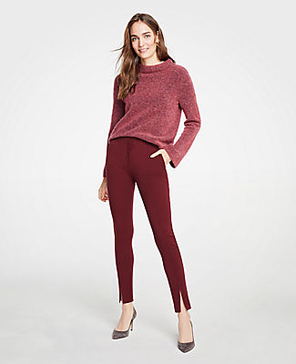 Designed with a comfy elasticized high waist, this endlessly flattering bi-stretch pair gets modern and chic with a sleek front ankle slit. Elasticized waist. Front zip with hook-and-bar closure. Slash pockets. Back welt pockets.