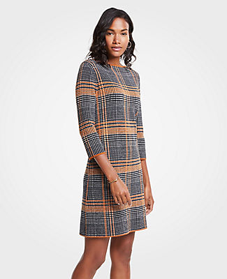 Shift into neutral with our plaid sweater dress, patterned in a warm palette of rich camel and smoky grey. Boatneck. 3/4 sleeves.