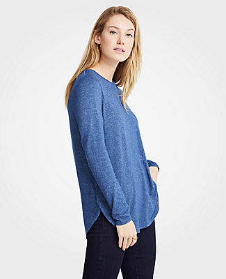 Perfect for mixing and matching, our tunic tee features a curved shirttail hem for an extra flattering effect. Jewel neck. Long sleeves. Shirttail hem.