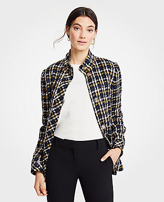 Coat check: cleanly structured and richly textured, our plaid jacket is tailor-made for the season. Stand collar. Long sleeves. Hidden snap front. Front flap welt pockets. Lined.