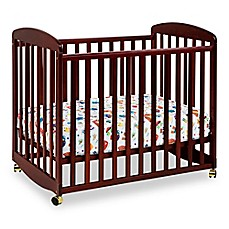 image of DaVinci Alpha Mini Rocking Crib in Cherry
