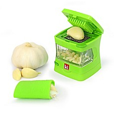 image of Kitchen Innovations Garlic Chopper with Garlic Peeler & Storage Container in Green