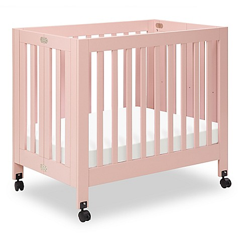 buy babyletto origami mini crib in petal pink from bed bath beyond