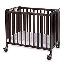 image of Foundations® HideAway™ Easy Roll Compact Fixed-Side Folding Crib in Cherry