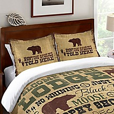 laural home welcome to the lodge standard pillow sham in brown