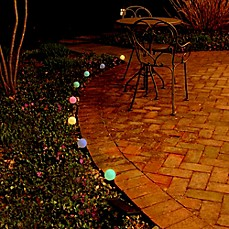image of Solar-Powered Plastic Lantern String Lights (Set of 8)