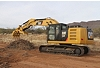 Excavator Rake and Pro Series Thumb working together for site clean-up.