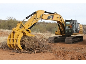 Excavator Rake and Pro Series Thumb working together to handle brush.