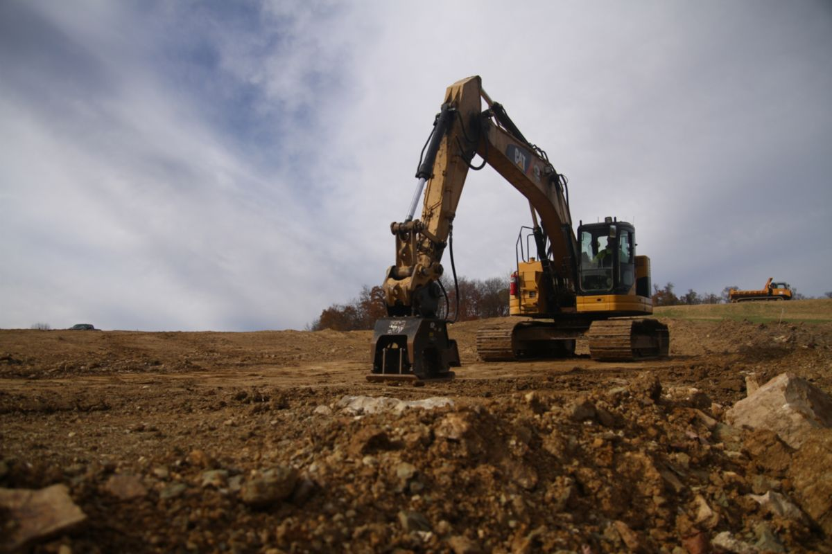 Compaction work with coupler and vibratory plate compactor.