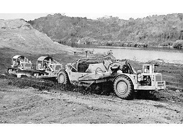 Dozers and scrapers work on the Panama Canal circa 1962.