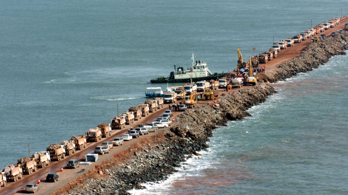 Excavators and dozers at work on the seawall.