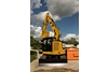 315F L Hydraulic Excavator working near obstacle