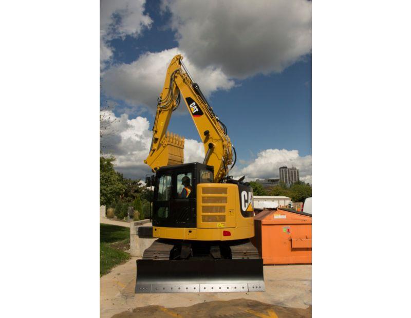 315F L Hydraulic Excavator working near obstacle