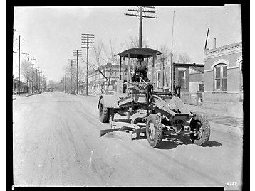 Auto patrol paving roads in 1931.