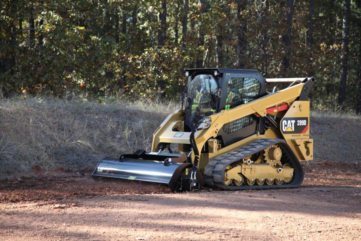 product-Cat® 289D Compact Track Loader and LT18B Landscape Tiller at Work