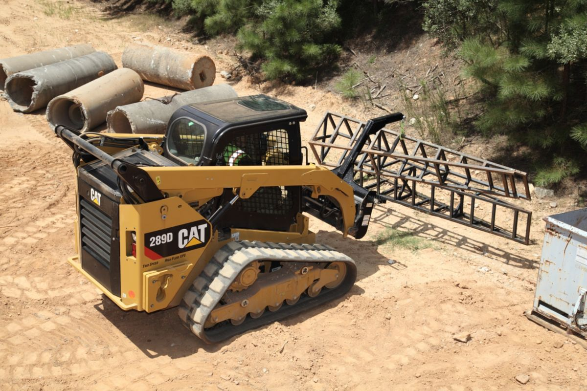 product-Cat® 289D Compact Track Loader and Material Handling Arm Moving Metal Structures