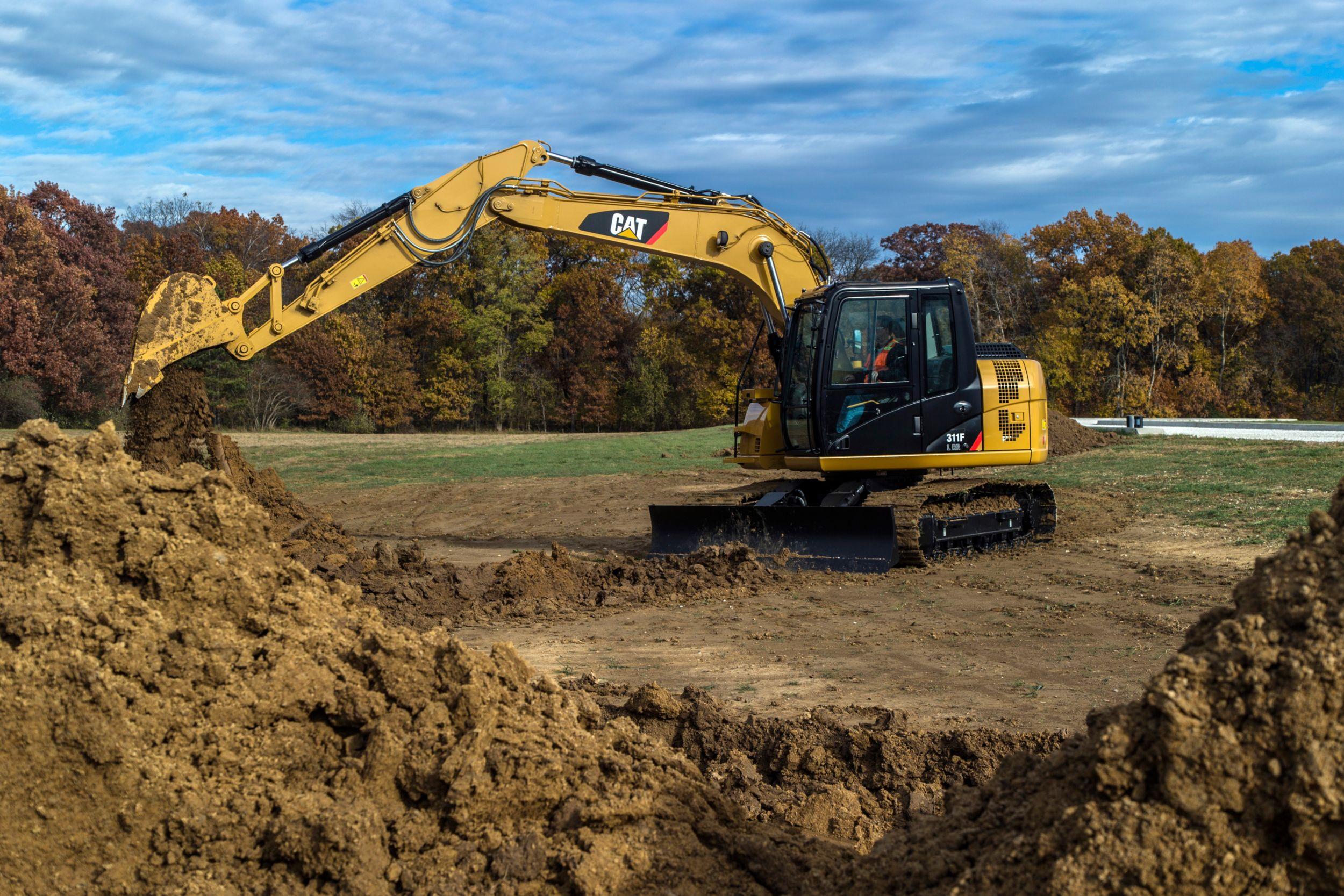 311F L RR Hydraulic Excavator digging>