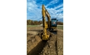 311F L RR Hydraulic Excavator digging a trench