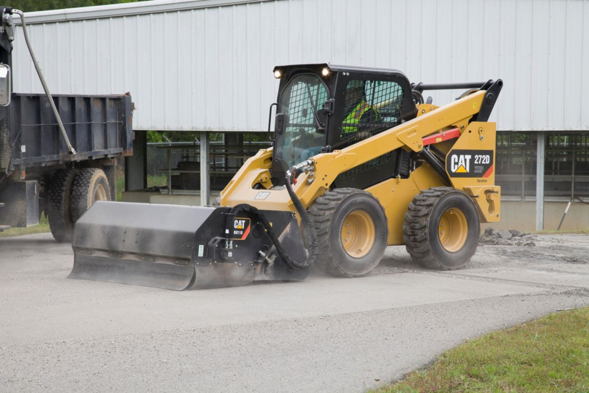 Cat® Utility Broom Sweeping and Collecting Debris>