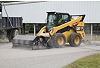 Cat® Utility Broom Sweeping and Collecting Debris