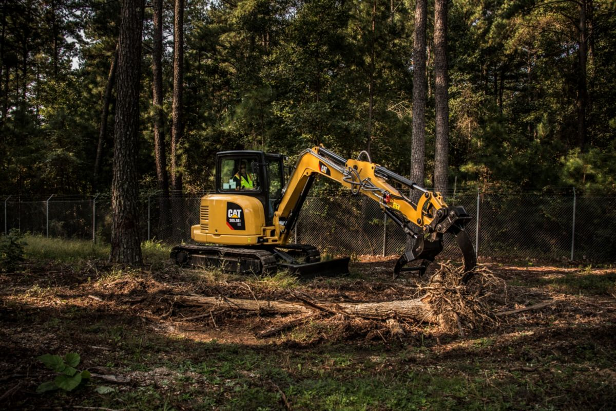product-Cat® 305.5E2 Mini Excavator with Thumb and Ripper in Working Application