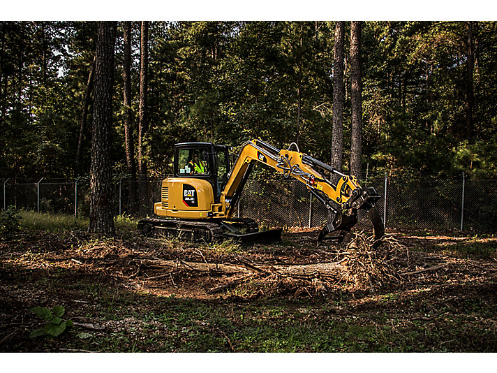 Cat® 305.5E2 Mini Excavator with Thumb and Ripper in Working Application