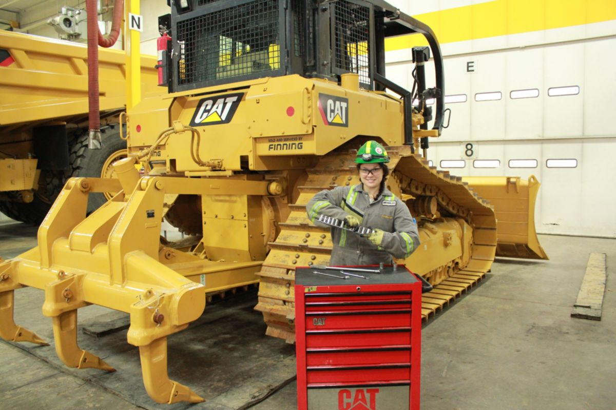 Young Technician in Front of Dozer