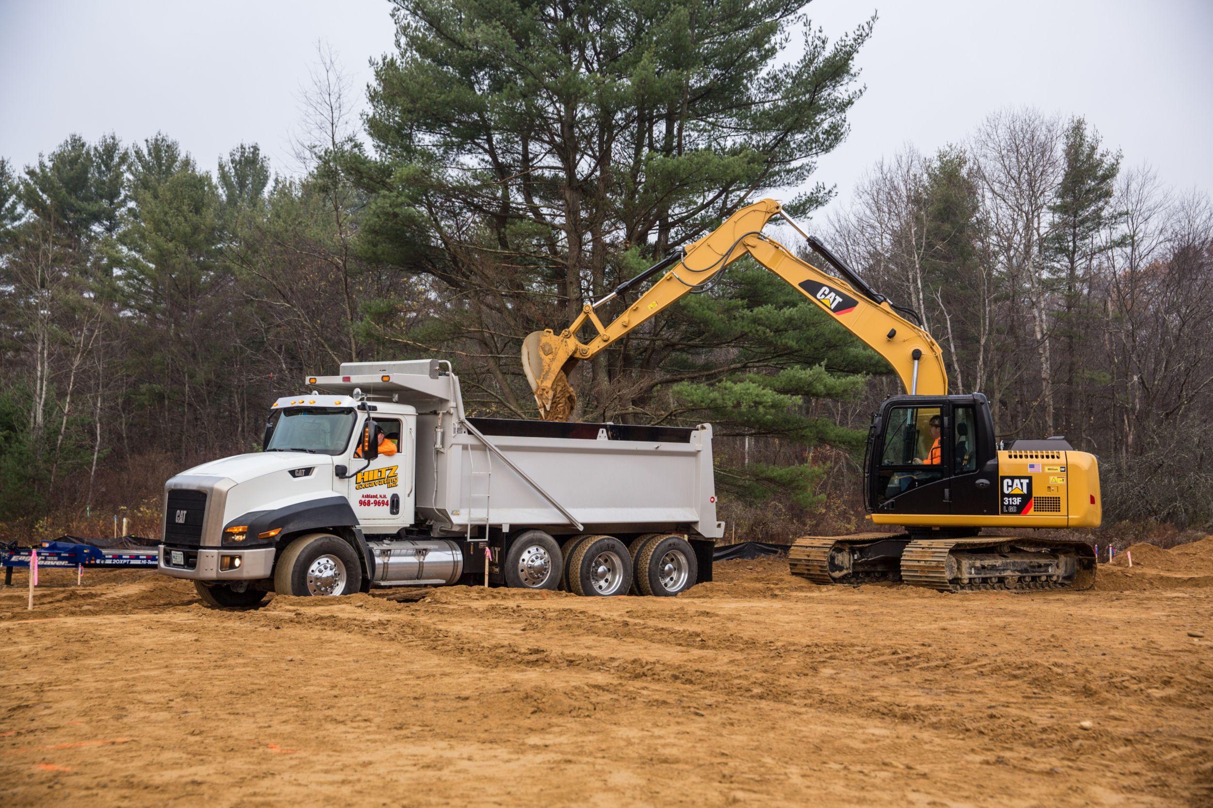 313F GC Hydraulic Excavator truck loading>