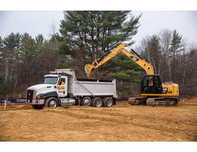 313F GC Hydraulic Excavator truck loading