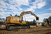 313F GC Hydraulic Excavator lifting concrete