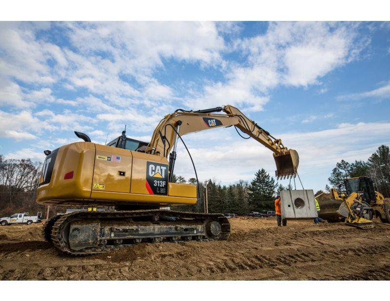 313F GC Hydraulic Excavator lifting concrete